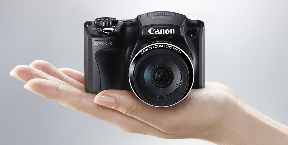 canon powershot sx500 is photo of camera in hand